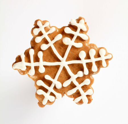 Gingerbread cookie in the shape of snowflake photo