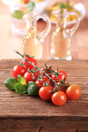 Bunch of red tomatoes on a piece of wood Stock Photo - 8118049