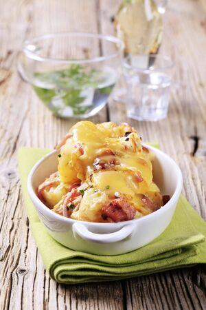prepared potato: Ham and potato gratin in a casserole dish