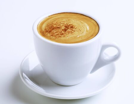 froth: Cup of coffee with froth and cinnamon