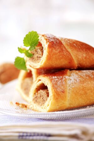 Sweet breakfast pastry with nut filling - closeup photo