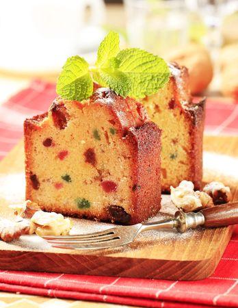 Slices of fruitcake garnished with mint sprig photo