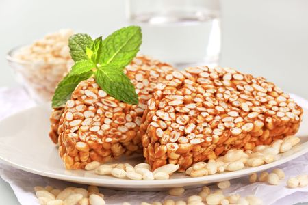 puffed: Puffed rice covered in caramel - closeup Stock Photo