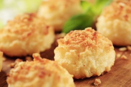 Coconut macaroons on a cutting board - detail Stock Photo - 8192384