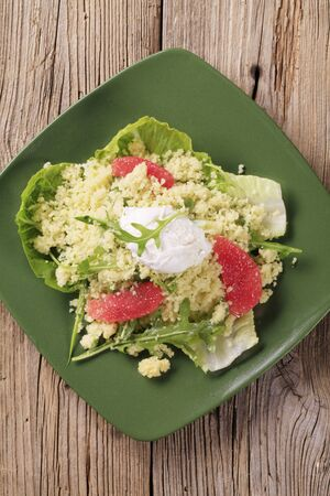 Couscous salad with poached egg on top photo