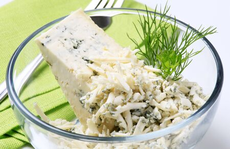 Blue cheese and fresh dill in a bowl photo