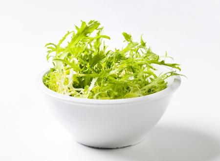 endive: Bowl of green curly endive - studio