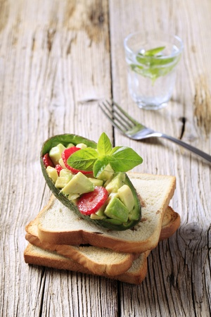 toasted: Avocado salad and toasted bread - closeup Stock Photo