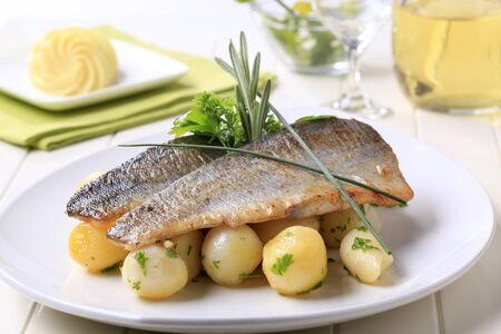 Pan fried trout fillets with potatoes - still life photo