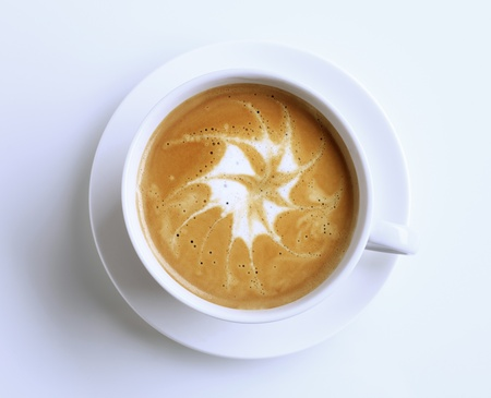Cup of latte with froth art - overhead Stock Photo - 8342886