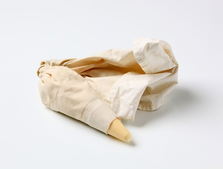 Pastry bag with plastic tip filled with cream photo