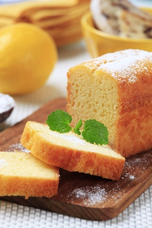 Slices of pound cake on a cutting board Stock Photo