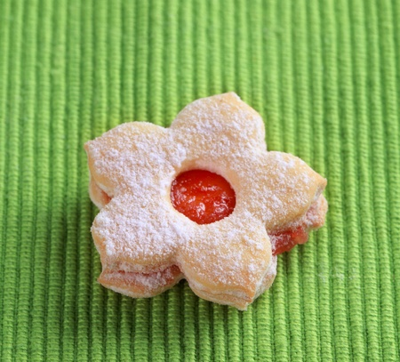 Jam biscuit on a green napkin - closeup Stock Photo - 8373598