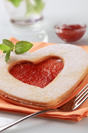 Heart shaped Linzer biscuit with jam filling Stock Photo - 8373609