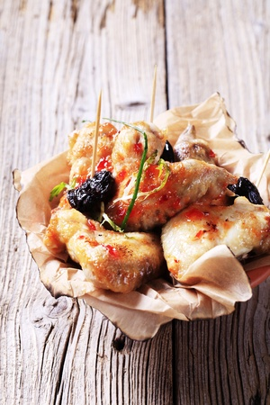 Marinated chicken wings and prunes - closeup Stock Photo - 8399634