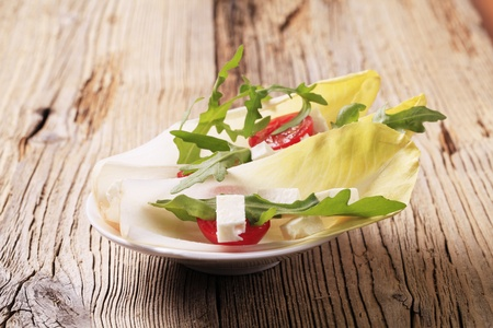 endive: Endive leaves, arugula and diced feta cheese Stock Photo
