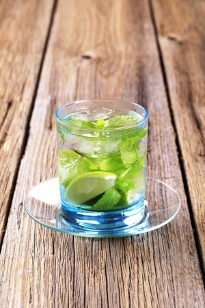 Glass of Mojito drink with ice - closeup photo