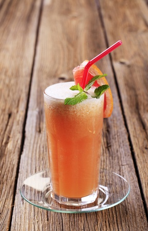 tall glass: Citrus fruit smoothie in a tall glass Stock Photo