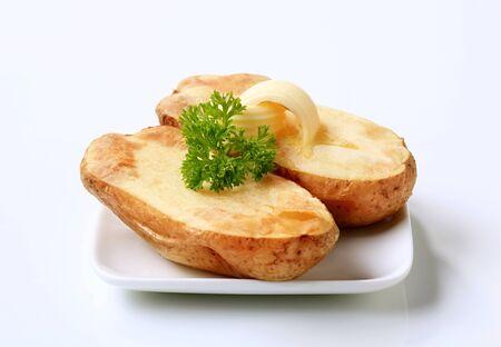 jacket potato: Butter curls melting on a baked potato Stock Photo