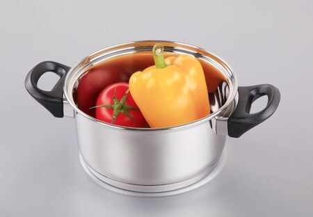 Fresh tomato and pepper in a pan photo
