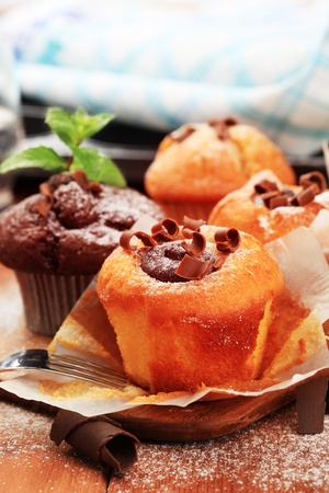 Muffins and chocolate filled sponge cakes - still photo