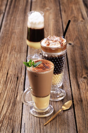Coffee and chocolate drinks in tall glasses photo