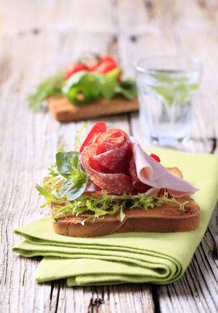 Ham and salami on toast  - still life photo