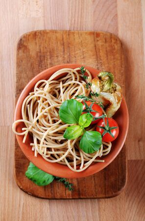 Cooked whole wheat spaghetti in a terracotta bowl Stock Photo - 8616267