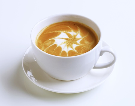 froth: Cup of latte with froth art - studio Stock Photo
