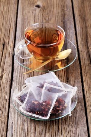 Cup of tea and nylon tea bags  photo