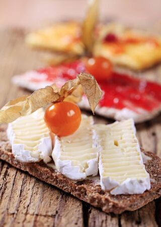 crispbread: Crispbread with slices of cheese and jam Stock Photo