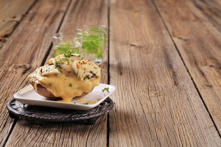 twice: Double cheese twice baked potato sprinkled with parsley Stock Photo