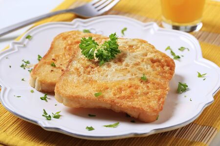 toast bread: Two slices of French toast on a plate Stock Photo