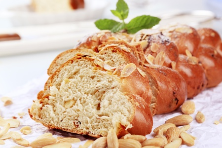 Sweet braided bread with almonds and raisins photo