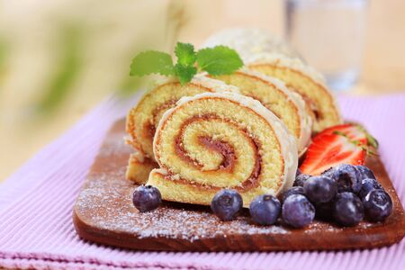 Swiss roll glazed with white chocolate icing photo