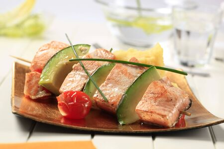 Salmon and avocado skewer with mashed potato photo