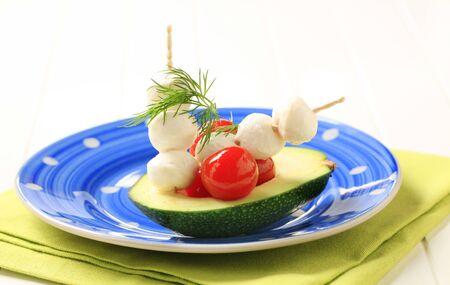 Avocado, cherry tomatoes and baby mozzarella  Stock Photo - 8766659