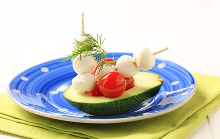 Avocado, cherry tomatoes and baby mozzarella Stock Photo - 8766659