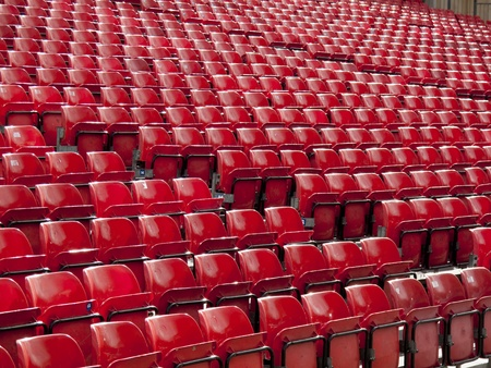 Rows of red seats at a stadium  Stock Photo - 8766690