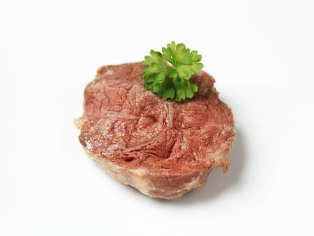 shin: Slice of cooked shin beef meat - studio Stock Photo