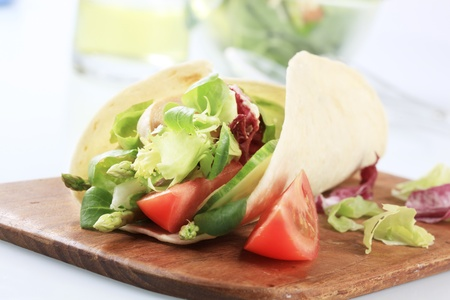 corn tortilla: Corn tortilla filled with fresh vegetable salad