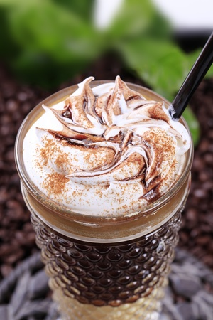 Liqueur coffee with whipped cream and chocolate sauce photo