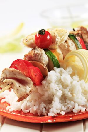 Chicken shish kebab on bed of white rice photo