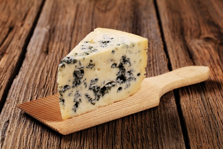 Blue cheese on a wooden serving board photo