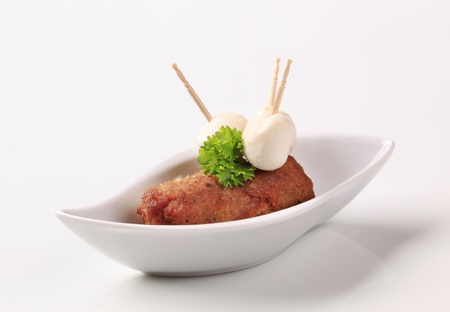 Minced meat kebab and baby mozzarella cheese photo