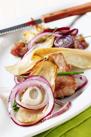 endive: Pan roasted pork with onion and endive leaves