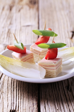 endive: Ham and cheese canapes and fresh endive