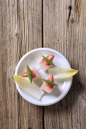 endive: Ham and cheese canapes and endive - overhead