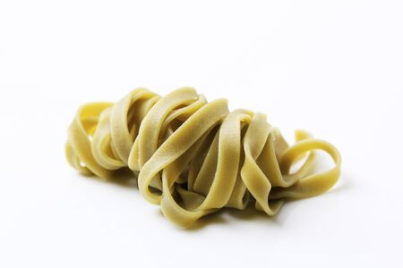 ribbon pasta: Cooked spinach ribbon pasta - studio shot