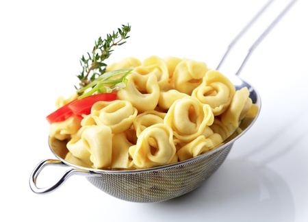 sieve: Cooked stuffed pasta in a metal sieve  Stock Photo